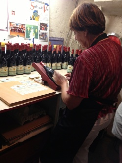 This lady and her husband owned the next vineyard we visited. We watched her meticulously put labels on the bottles. Jeff gave it a try and did his own label.