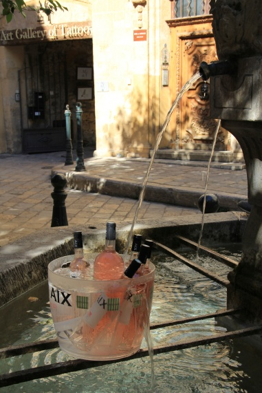 How can you not love a town that uses its fountains to cool bottles of rosé?